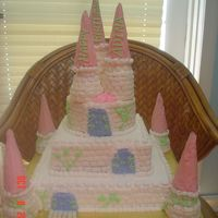 Castle Cake All buttercream frosting. Brick effect done freehand with flat side of basketweave tip. Towers are buttercream frosted wafer cones on...