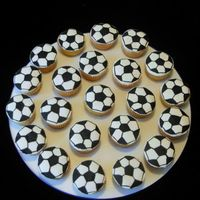 Soccer Cupcakes I did these to go with my son's soccer jersey for his banquet. I cut out white fond. circles and drew the pattern with a black edible...