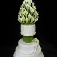 Calla Lilly Cake I made this dummy cake for our cake studio, covered in fondant with gumpaste calla lillies