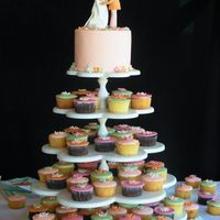 Coral Minis And Topper cupcakes topped with fond. circles and a 6 in top tier covered in fond. Couple made from gumpaste and fondant, TFL!