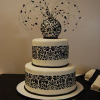 Black And White Wedd Did this cake for a family member's wedd. covered in fondant with stenciling around the sides and jewelry topper.