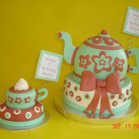 "Teapot And Teacup Birthday Cake Made for a 1st birthday tea party! The teacup is the smash cake, a 2"" on top of a 4"" cake. The tepot was the sports ball on top..."