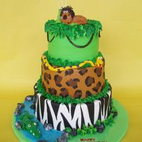 "King Of The Jungle This three tiered cake was designed for a little boy turning 6 who was having a ""King of the Jungle"" themed party. It's a..."