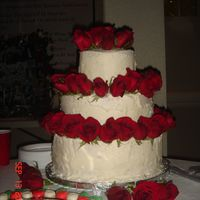 Wedding Cake With Roses My First wedding cake!!!!! Icing was soft due to outside hot and humid... but they stay well put together. Roses are real