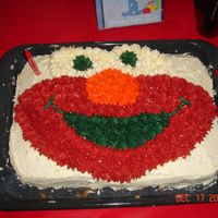 "Elmo Made this for my son 1st Bday... did not use an ""elmo"" pan... I frost it myself using the elmo face as a pattern..."