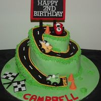 Racing Car Cake Chocolate mud cake with all fondant accents