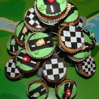 Racing Car Cupcakes Vanilla butter cupcakes with ganache and fondant accents