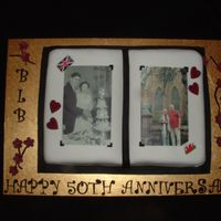 50Th Wedding Anniversary Wilton open book choc mud cake, covered in fondant and edible image on top with fondant hearts, flowers & writing.