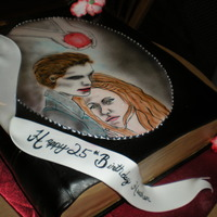 Twilight Book 1/2 sheet cut and shaped and fondant covered to look like a book, added different features about the movie. Hand made gumpast iris.
