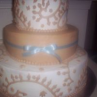 Cornflower Blue   All buttercream wedding cake with a cornflower blue ribbon around the middle tier.