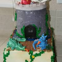 Dinosaur Cake This was a fun little 1/4 sheet cake with a castle tower made of rice crispie rounds, covered in fondant - I used a texture mat for the...