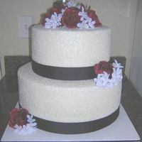 "Two Tier Round With Rock Sugar This cake was a 14"" and 10"", 6 1/4"" high tiers - loved it! They were on a budget so the flowers are silk but this cake is..."