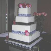 4 Tier Square Cake With Zebra Ribbon This cake frosted in buttercream and topped with rock sugar. Such an easy technique and can save a bride some money. Trimmed in grosgain...