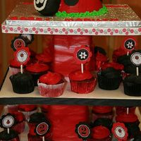 Ladybug Cake With Cupcake Tower Ladybug cake with fondant decorations and cupcake stand to match