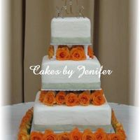 Sage And Orange Square Wedding Cake The ribbon is sage with silver trim. Silver beads line the bottom of ribbon. Orange roses are in between each tier.