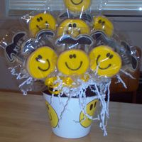 Kiss And Smilie Face Bouquet Made for 13 year old who loves KISS the band. I wanted to incorporate the long tongue, but I didn't get a chance to. The back top...