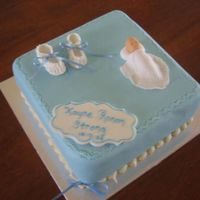 Christening Cake   Fondant booties and baby.