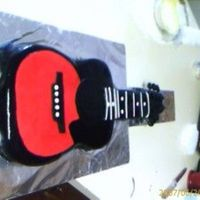 Guitar Cake I did this for my boss. His son plays guitar and was coming home from college. THis was my first commissioned cake.