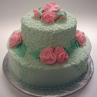 Mint Roses I made this cake for a friend of mine who was turning 21. She is really girly and she loved her sweet cake. The cake is covered in BC with...