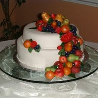 Tusican Wedding  I loved making all the little fruit even thought it took forever. All the fruit is made from MMF and the cake it also covered in MMF. The...