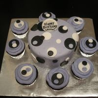 Lauren's B-Day Last minute order. A 6-inch layer cake covered in mmf . Cupcakes with buttercream and fondant circles.