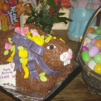 3D Bunny this is my first sculpt cake. Chocolate frosting with Fondant accents. it was three tiered, with six recipes of chocolate frosting, lol,...