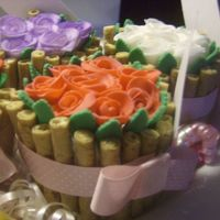 Flowers In A Basket Hi this is a jumbo cupcake, with fondant flowers.