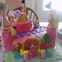 Princess Castle Cake A Castle cake for my niece Hannah's 4th birthday cake. The columns are made of rice crispy treats. The cake is a chocolate cake and...