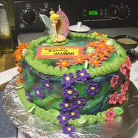 Fairy Cake this is my Niece Hannah's 5th birthday cake. Air brushed with fondant flowers.