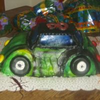 Car Cake my first attempt at airbrushing a car with the hulk colors.