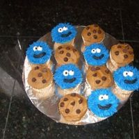 Cookie Monster Cupcakes cookie monster cupcakes to go with sesame street cake for a 2nd birthday.