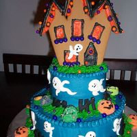 Haunted Halloween Cake This cake is a two layer Haunted House Cake.It is a 12 inch on the bottom, and a 8 inch on the top. The House is made from a gingerbread...