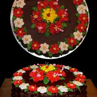 Basketweave_2_Copy.jpg I did this cake tonight in class. Chocolate buttercream with chocolate cake. Royal flowers and bc leaves.