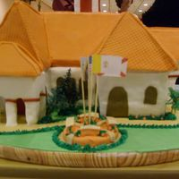 50Th Anniversary Of A Church All in fondant. Roof are in foam covered with fondant. landscape made with butter cream icing and plastic palm trees.