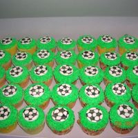 Soccer Cupcakes Cupcakes with BC grass using grass tip. Soccer balls are fondant decorated with edible food writers. Got idea from several others here on...