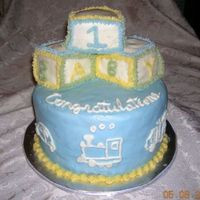 Baby Blocks Cake For Boy White double layer 8 inch rounds with sculpted blocks on top. Had a hard time covering the blocks with BC (there was a lot of icing on the...