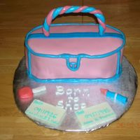 Pink And Blue Purse Cake Darn Good CC with chocolate ganache filling and strawberry MMF. Accents on cake are MMF painted with pearl dust. Handle, nail polish and...