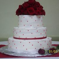 Round White With Red Dots  This cake is a sour cream pound cake with buttercream frosting. It is white with red dots and rhinestones on each tier. The topper is a...