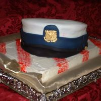 Coast Guard Hat This was for a man graduating from Coast Guard boot camp. Everything is edible even the gold medallion and buttons.