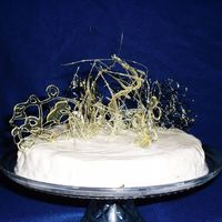 Vanillabean Cheesecake With Spun Sugar   The cake is a vanilla bean cheesecake with an abstract design of spun sugar on top. The