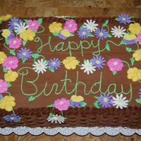 Birthday Celebration   Chocolate cake with chocolate buttercream. I had a lot of fun making all the different kinds of flowers.
