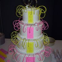 Pink And Yellow Wedding Cake This cake is kinda crazy for a wedding, but it''s what the customer wanted, so...buttercream with fondant accents