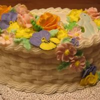 Wilton Class 2 Basket Weave Cake I made the orange roses and light green leaves out of buttercream,,everything else is royal icing, and the birds are color flow.