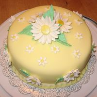 Daisy Cake This cake is from my last Wilton class. It's covered in fondant with gumpaste flowers & leaves.