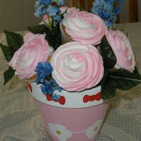 Rose Cupcake Bouquet these are regular cupcakes, with buttercream frostingin a Hello Kitty pot