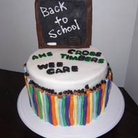 Back To School Cake Devils food cake with brown sugar buttercream covered in white fondant and decorated with a fondant chalkboard and pencils.