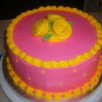 Nita's Cake Pink w/ yellow ribbon roses. My sister came to visit and wanted a cake. She said that her favorite colors were pink and yellow. So that it...