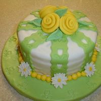 Fondant And Gumpaste Final Yellow cake w/chocolate icing covered with MMF. Gumpaste and fondant accents. My very first ribbon roses.