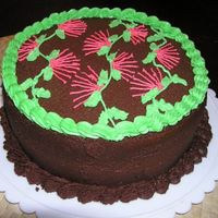 Lehua Cake Chocolate cake w/ strawberry cream filling, very yummy. Design is the Hawaiian Lehua blossom.