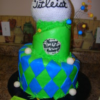 Whimsical Golf Birthday Cake   Whimsical, 3 tiered golf ball topped birthday cake iced in buttercream with fondant accents.